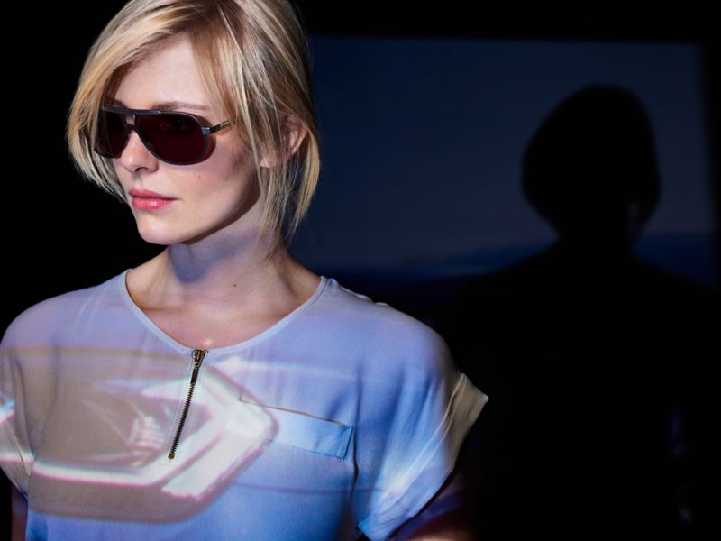 A woman wears sunglasses from the VW R Collection