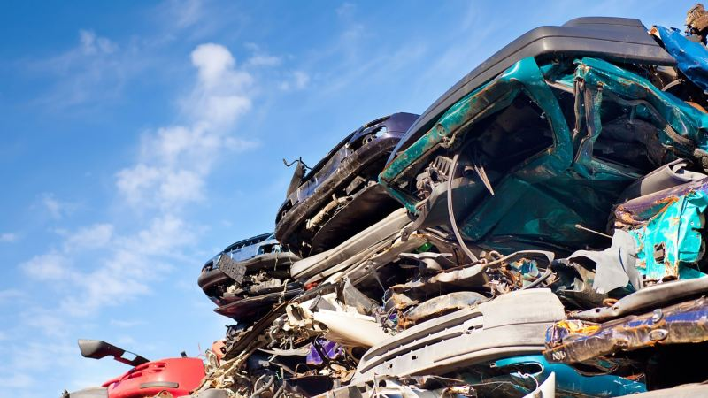 Some scrapped VW cars at a scrap yard, ready to be recycled