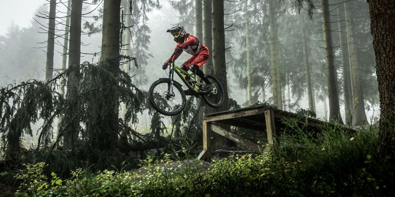 Christian Junker is riding his mountain bike down a slope