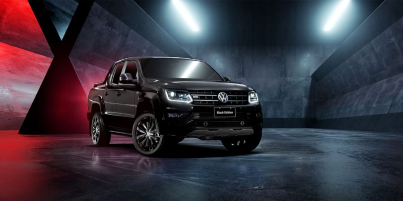amarok v6 black edition stands on a industrial vibe background