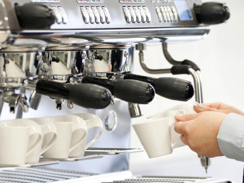 Cups beneath an espresso machine