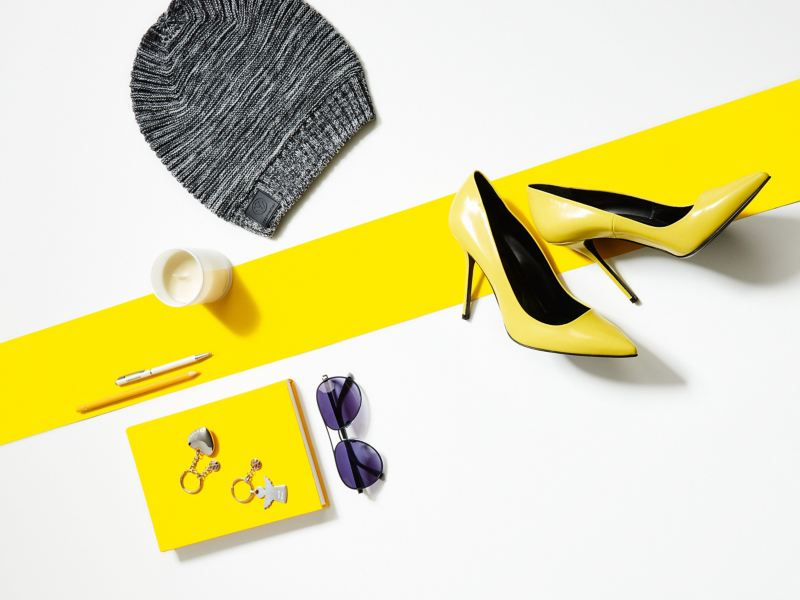 A selection of products from the Volkswagen Collection in brilliant yellow