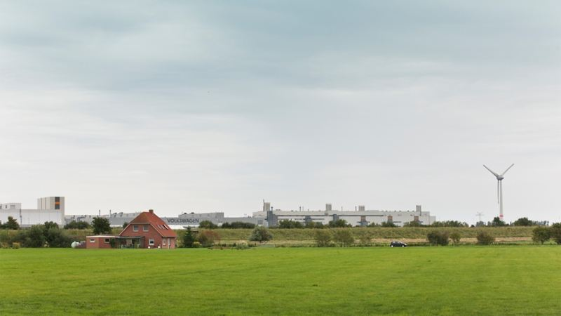 Green meadows and a windmill at the Volkswagen site in Emden