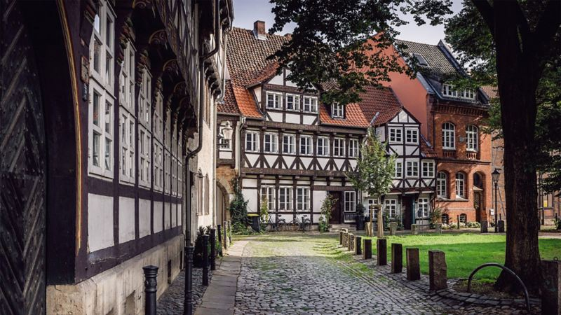 Half-timbered houses next to a park