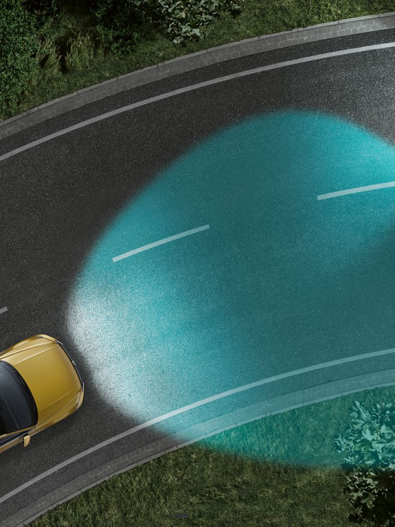 diagrammatic representation of the dynamic cornering light using the example of the Arteon, vehicle illuminates the road in a bend and partially dims for an oncoming vehicle