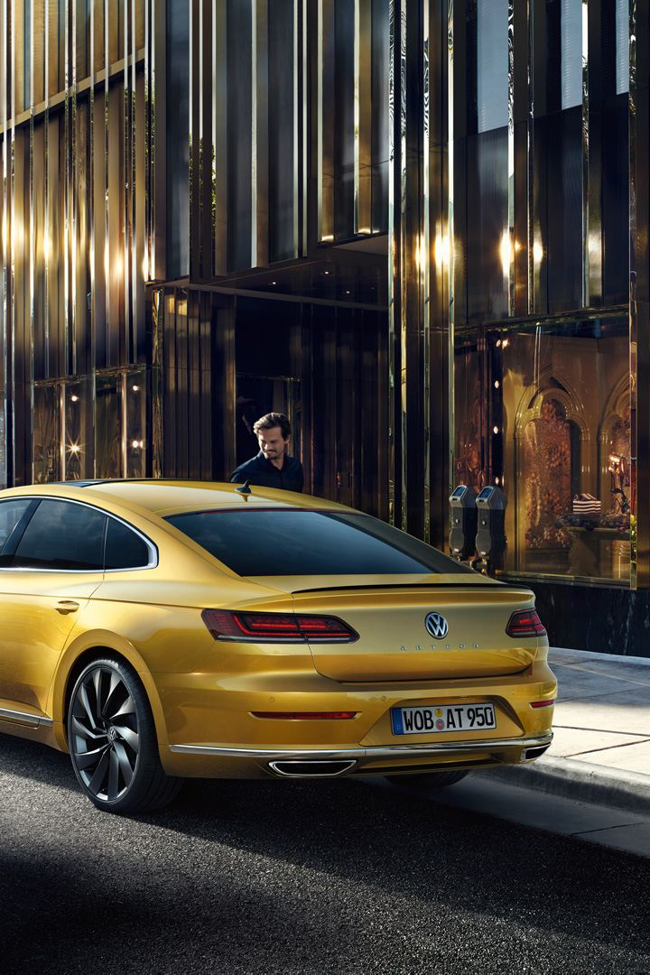 VW Arteon parking in front of a shop