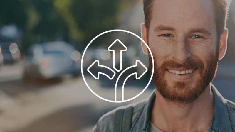 Icon representing multiple directions over a photo of a man looking at camera