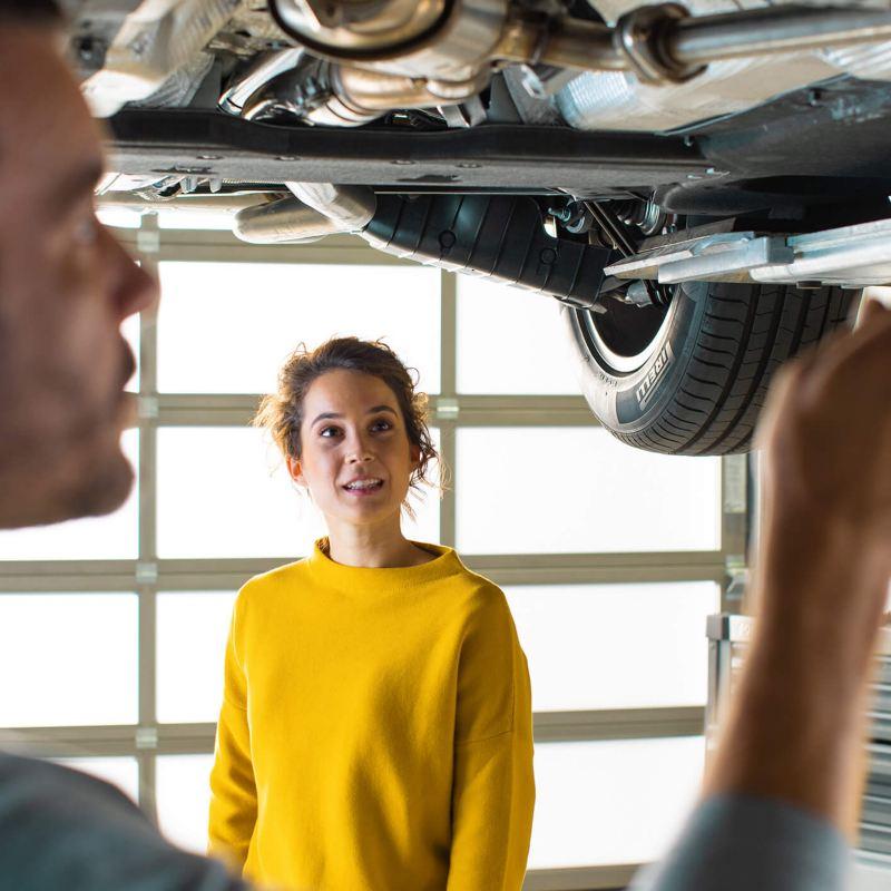 Volkswagen technician fixing car