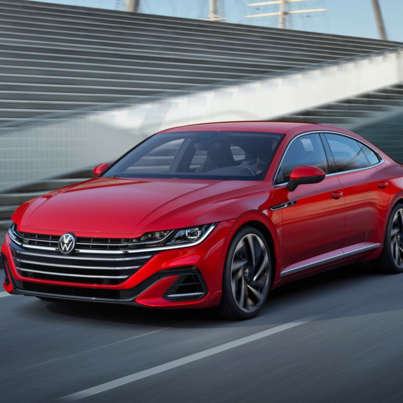 A red 2021 Arteon in motion