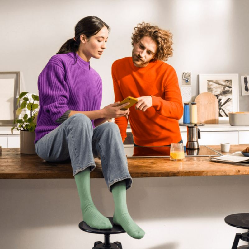 A man and woman looking at a phone