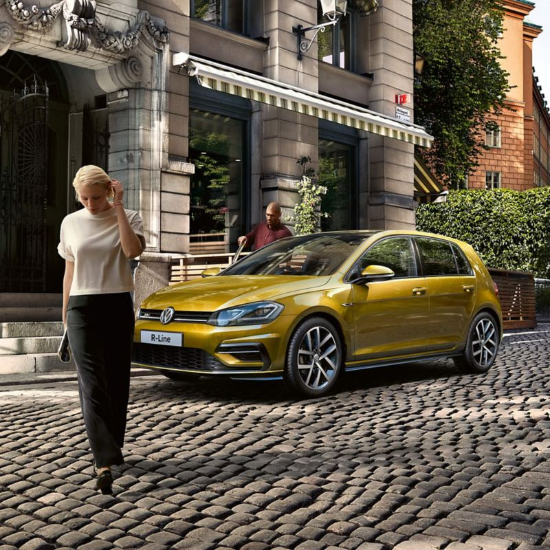 Yellow Volkswagen R-Line parked on a cobbled street