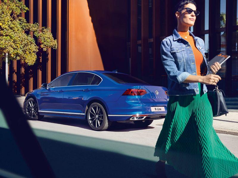 Woman walking next to a car