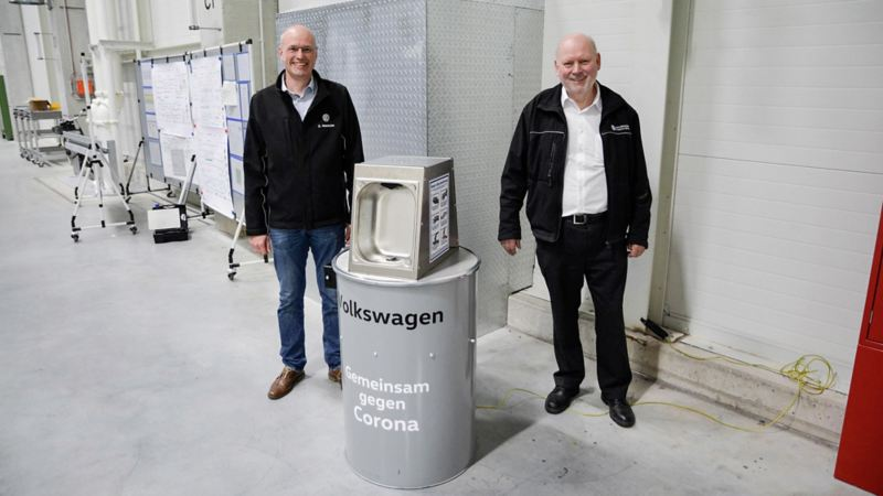 VW employees show disinfectant dispenser