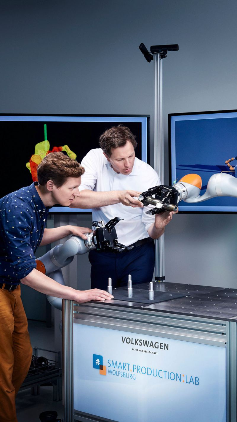 Two colleagues working on a robot