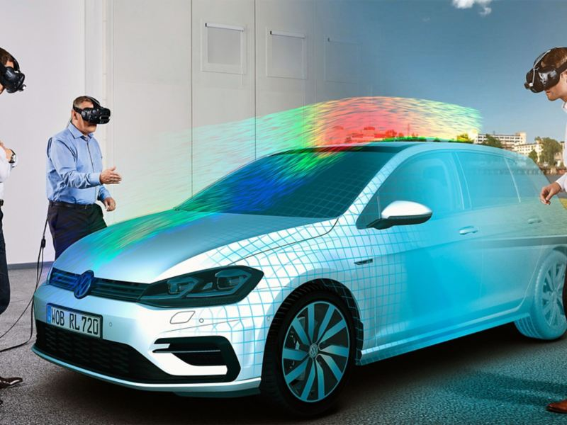 Three men wearing VR glasses next to a Volkswagen model