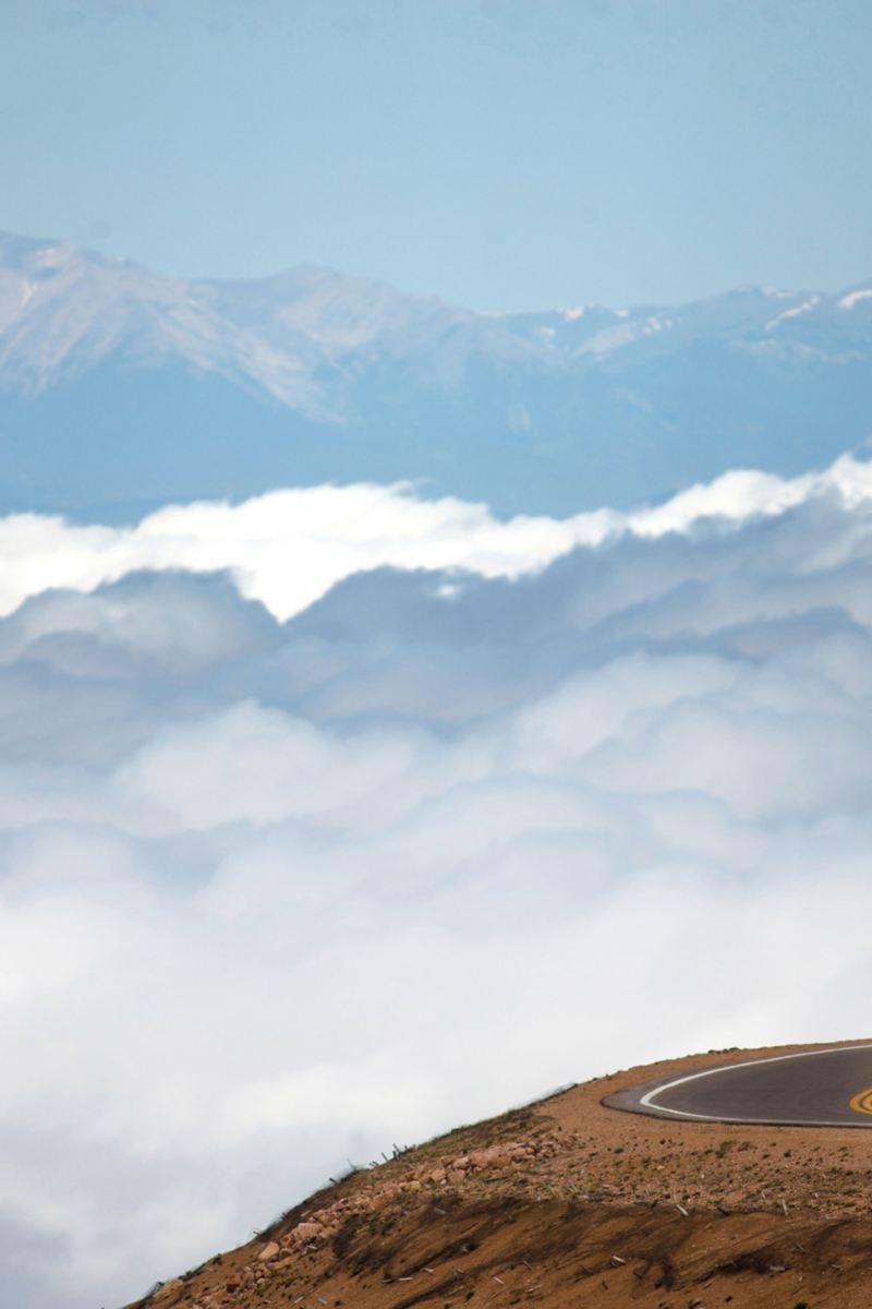 ID. R pikes peak with clouds and mountains in the background