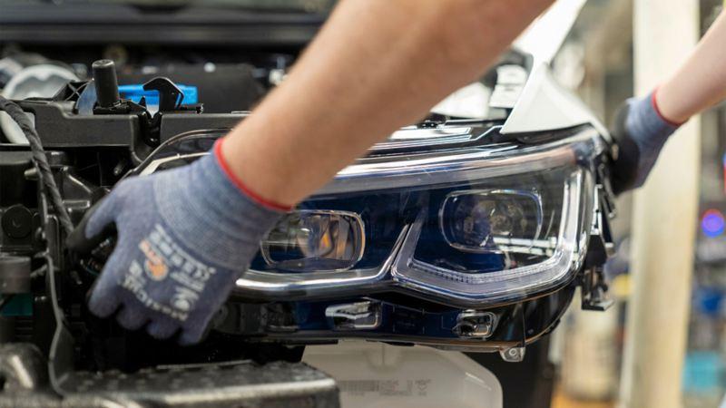 Close-up of assembling a headlight