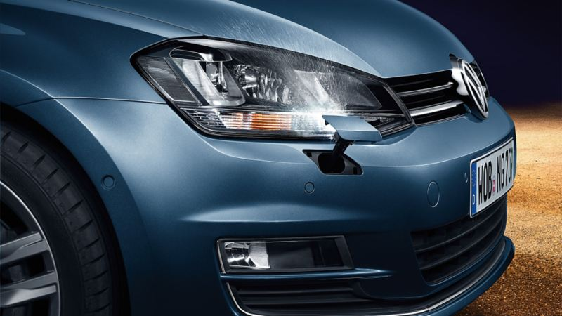VW Golf side view, headlight detail with headlight washer system