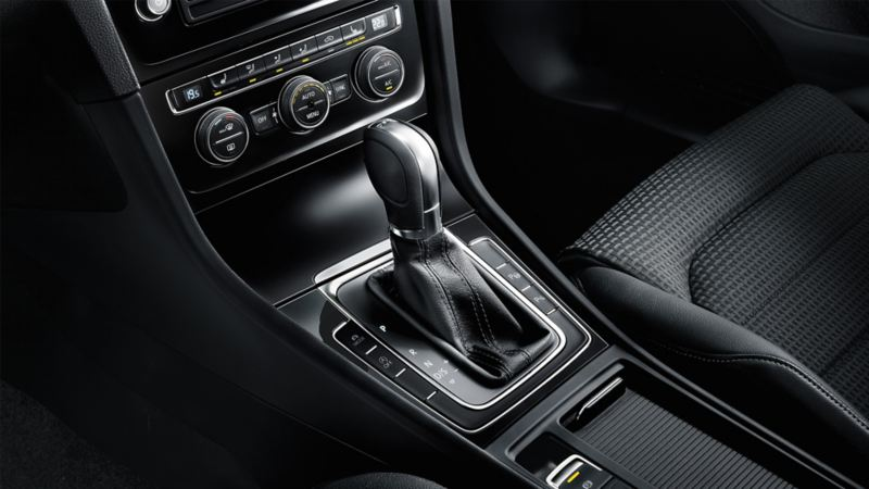Interior view of a VW Golf, clutch gearbox in centre console detail