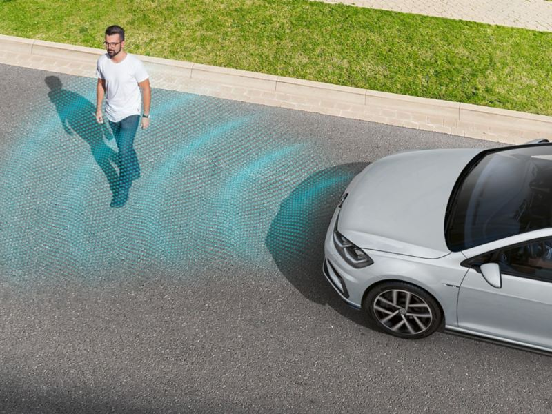 Man crosses a road, VW Golf recognizes him