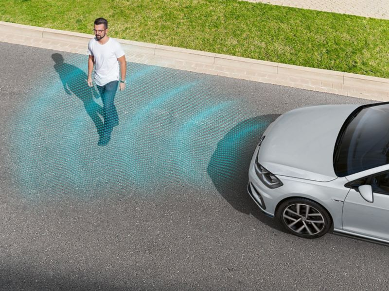 man crosses the road, VW Golf TGI detects him