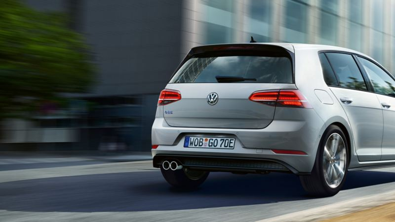 Golf GTE driving on a street, back view