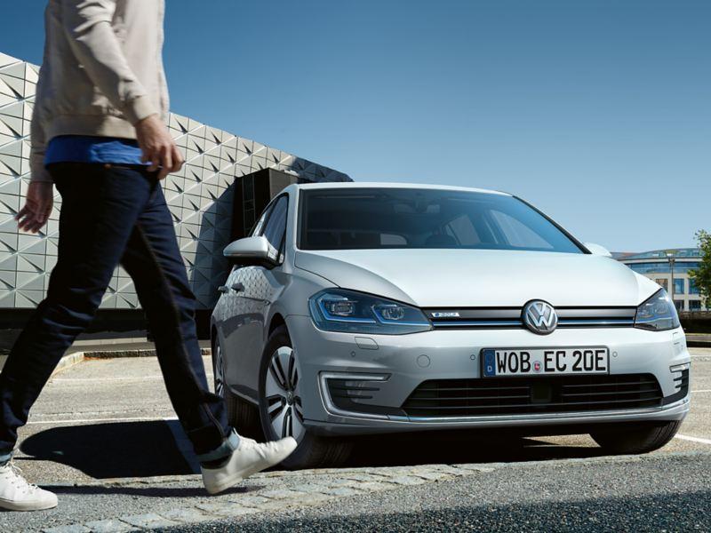 VW e-Golf parking, man walking by