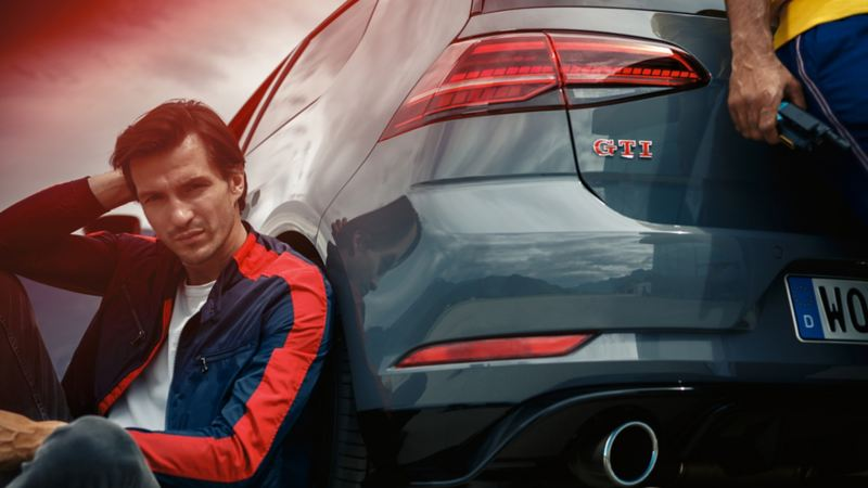 A man sitting in front of the Golf GTI TCR