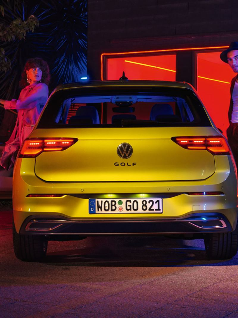 VW Golf rear view with people