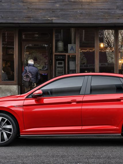 A Jetta GLI downtown await its owner getting a coffee