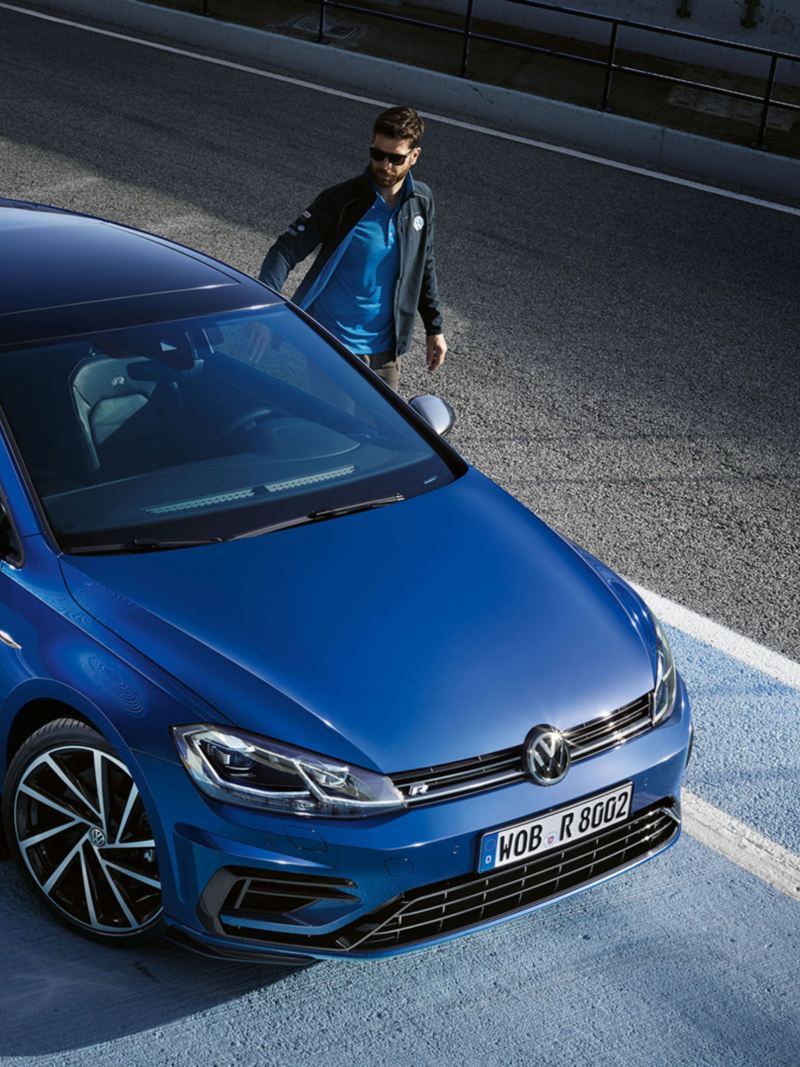 A man opening the door of a VW Golf R