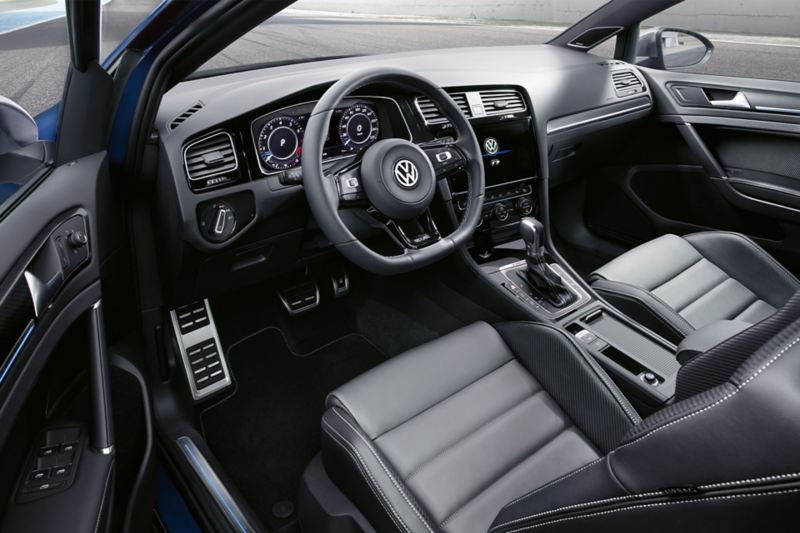 View through the open door onto the driver´s seat and cockpit of the Golf R