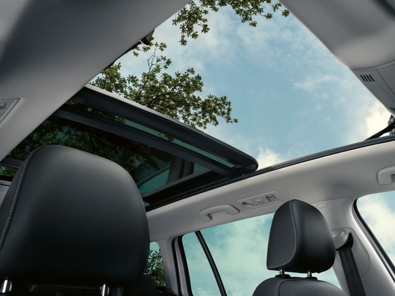 View through the open panoramic sunroof from the passenger seat VW Golf Estate