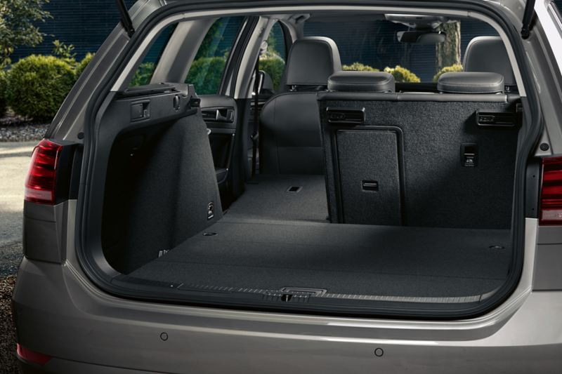Trunk with partly folded down back seat bench in the VW Golf Estate