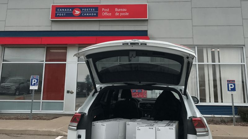 VW Canada delivering sanitizer to Canada Post.