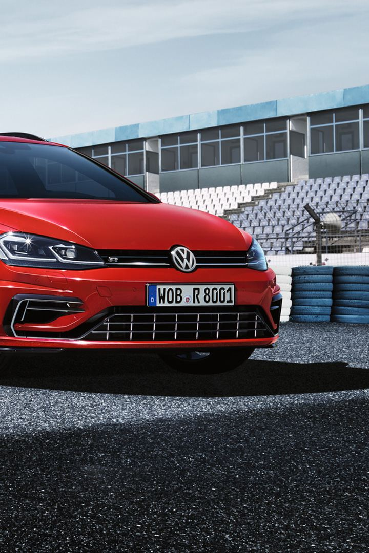 Golf R Variant driving on a racetrack, displaying both the front and the side