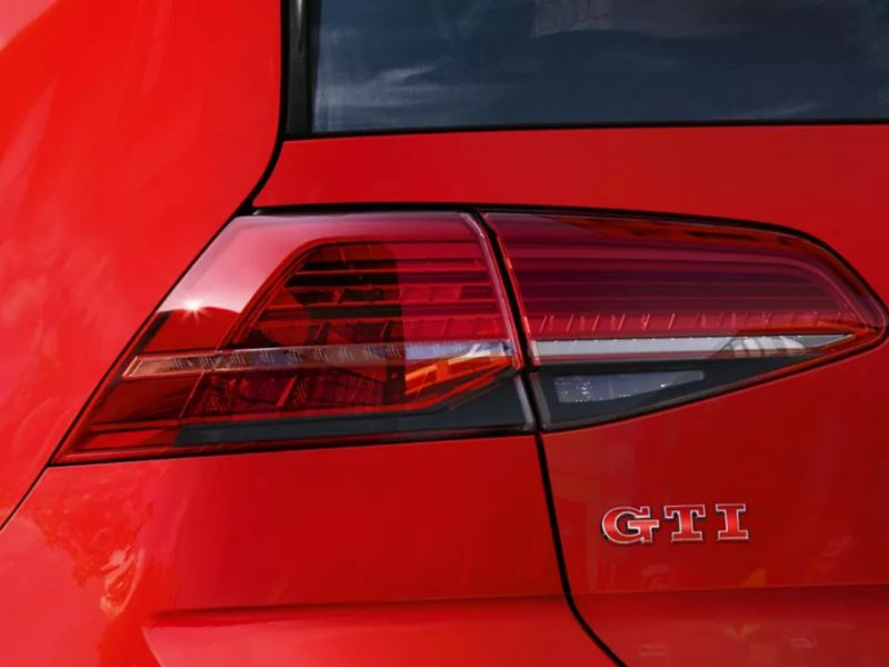 Close-up of the GTI badge on a red Golf GTI