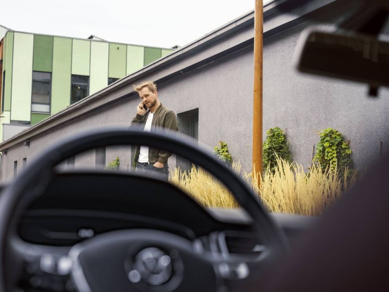 "Man in front of the VW car, link out to VW's ""warranties & coverage"" page"