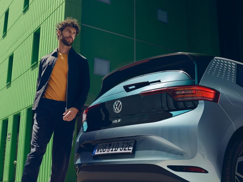 A man walks behind a Volkswagen ID.3