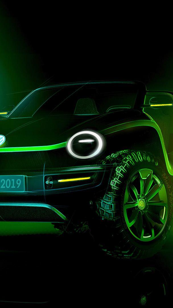 Le VW ID. BUGGY est situé devant des écrans lumineux, vert et bleu.