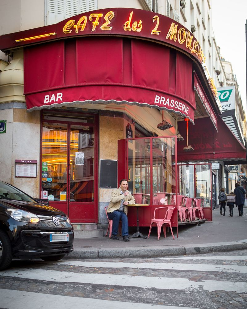 Alexandre Marie is sitting in a café, his e-up! is parked next to him