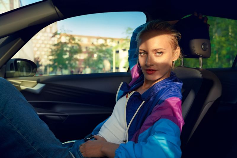 Young woman in the passenger seat of the VW ID3.