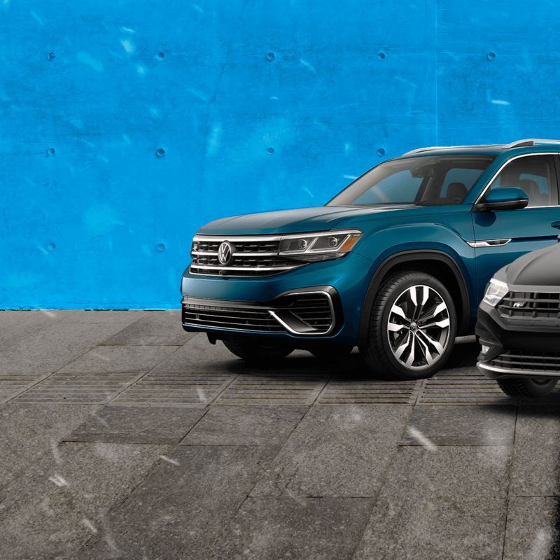 Two vehicles in front of a blue background, outgoing link to offers.vwmodels.ca
