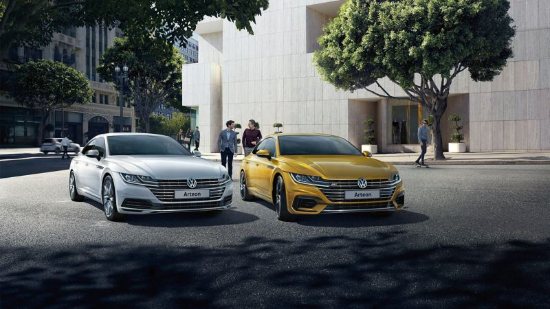 Parked Silver and Yellow Volkswagon Arteon