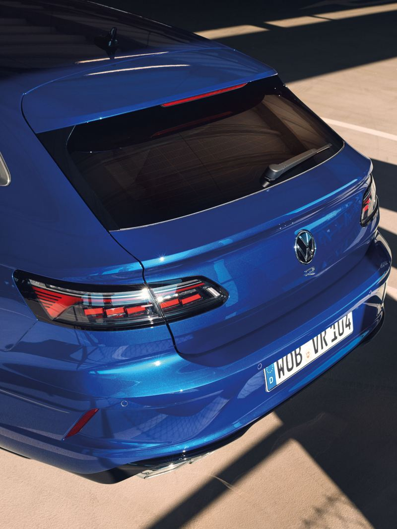 A blue VW R Arteon R Shooting Brake is parked in a multi-storey car park