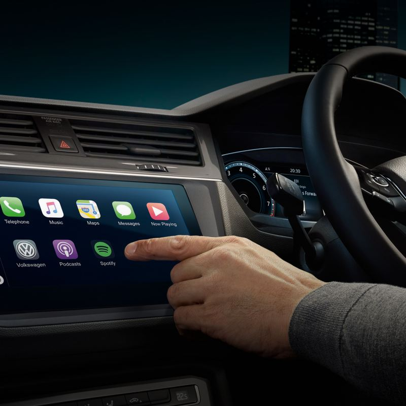 A hand touching a navigation system screen