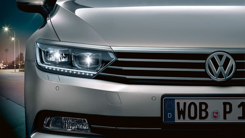 Front view of Volkswagen at night, headlight detail