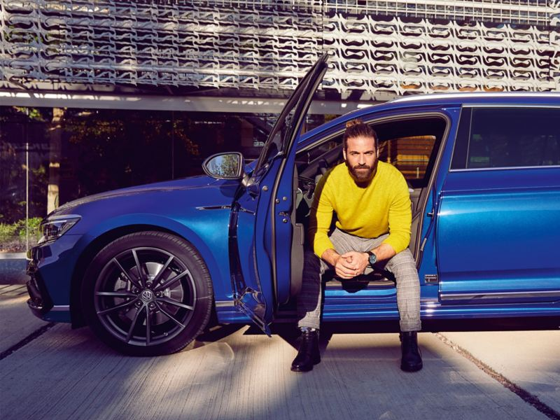 Man sitting inside a Volkswagen
