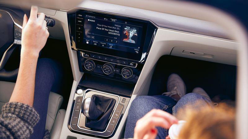 VW Passat exterior, mobile key Woman opens car with smartphone