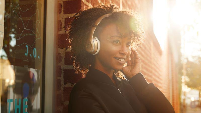 Women wearing Headphones from Beats